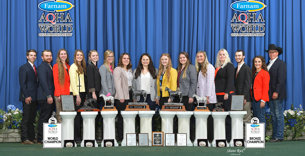 Team photo at championship with trophies.