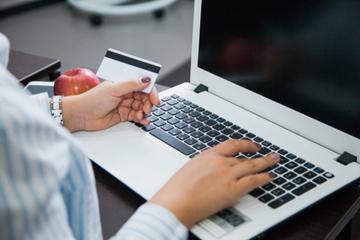 Economic stimulus may arrive as prepaid debit card