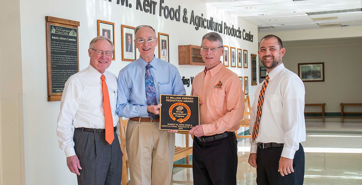 President Burns Hargis, Roy Escoubas, Tom Coon and Bobby Horner pictured with the FAPC energy award.