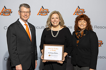 Weeks honored with Award for Excellence in Teaching