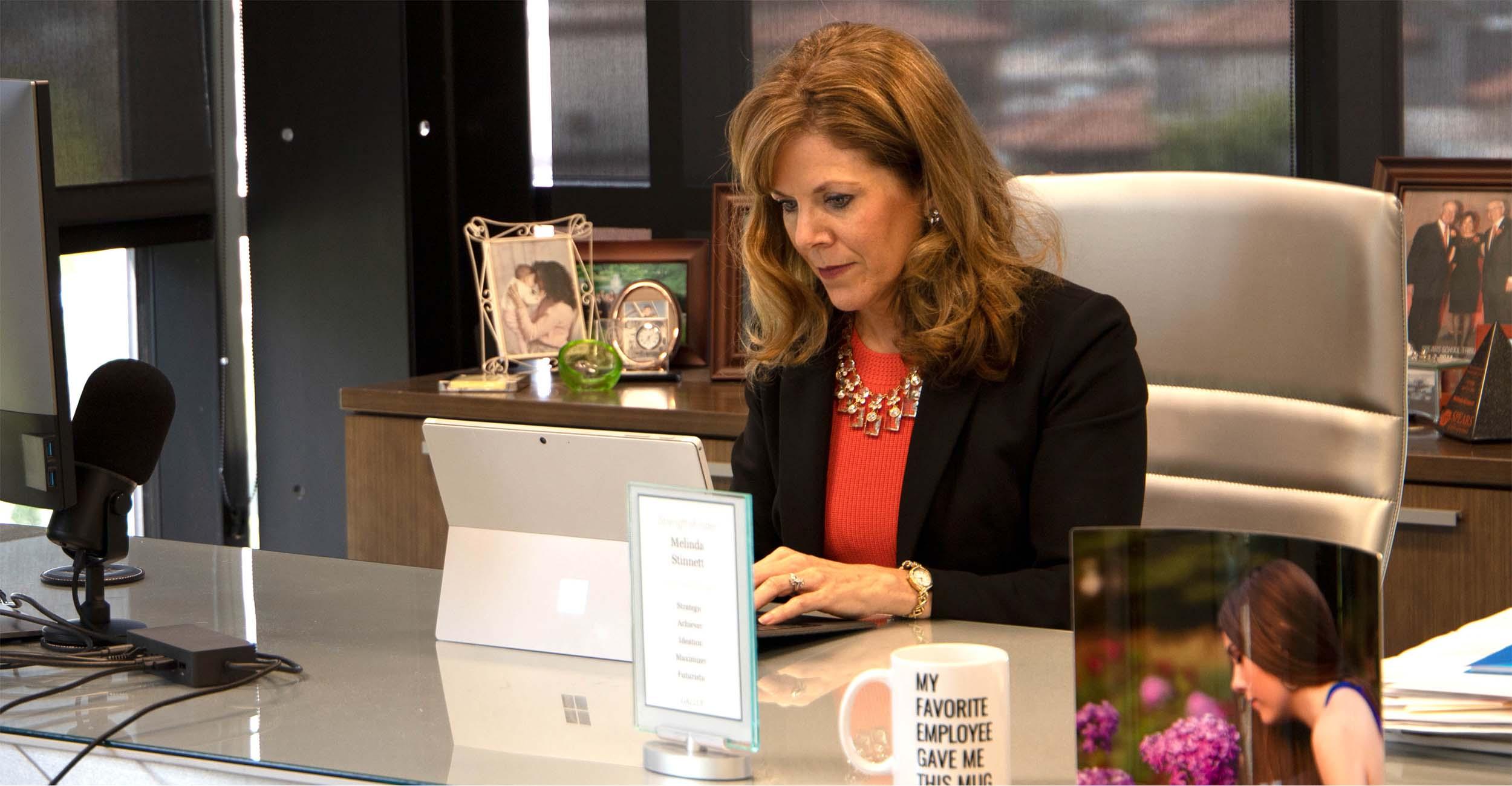 Melinda Stinnett working in the Stinnett and Associates headquarters.