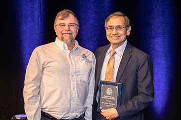 Sharda honored by global association as AIS Fellow
