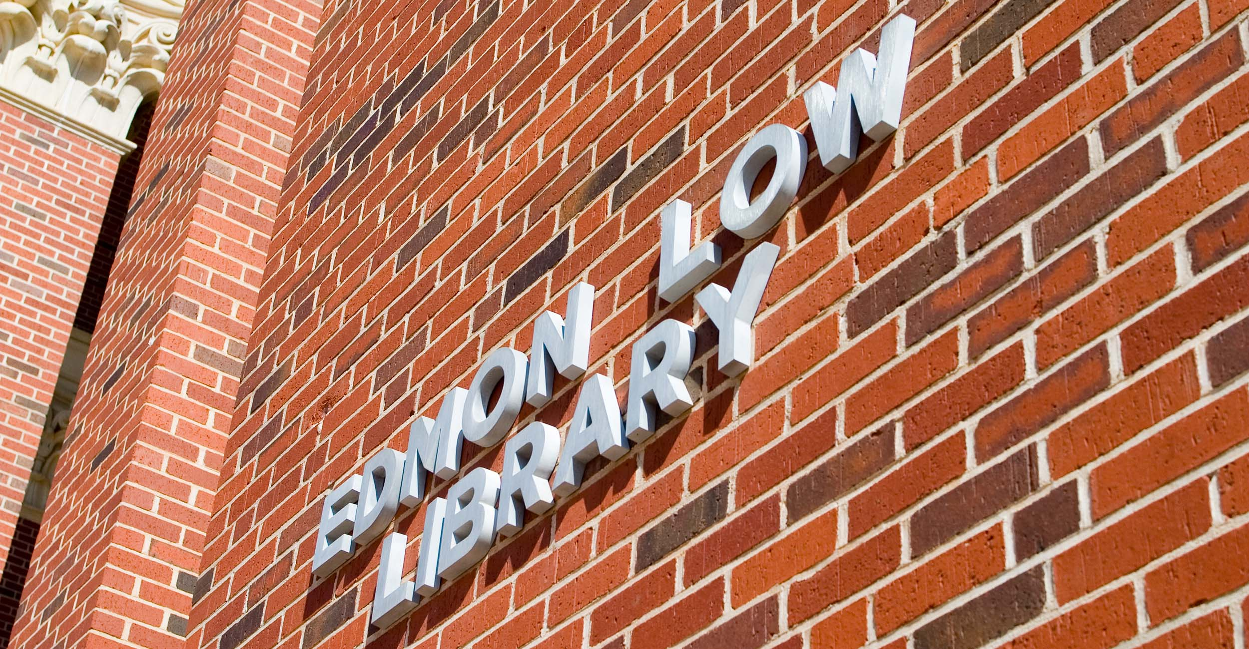 A photo of the sign for Edmon Low Library.