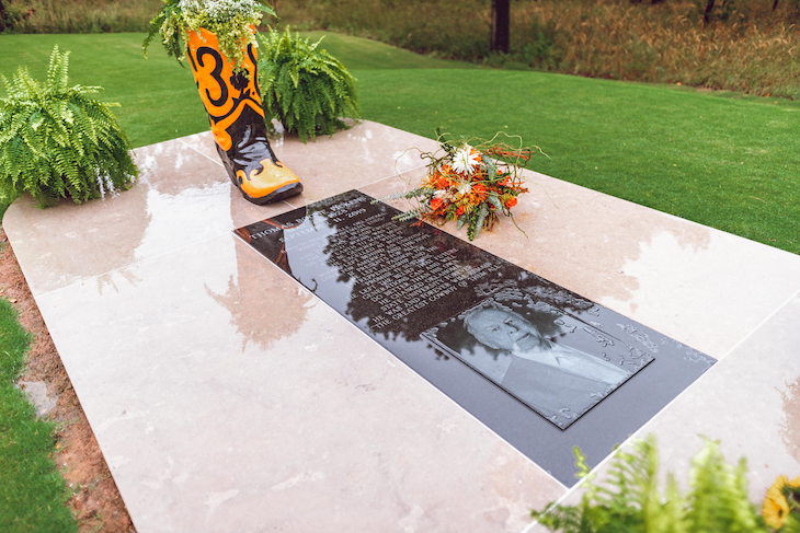"Boone Pickens' gravesite is adjacent the ""Holdenville House,"" now located at Karsten Creek Golf Club on the OSU-Stillwater campus."