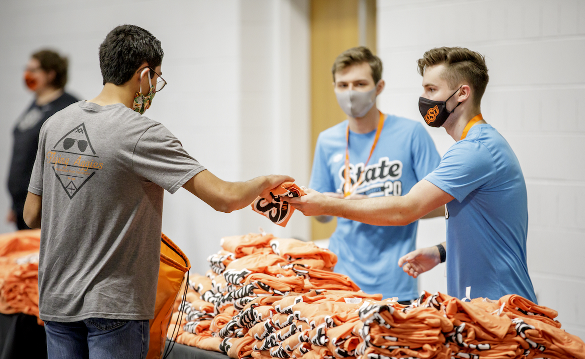 An OSU student receiving instructions and a goody bag Friday during the first move-in day of the fall 2020 semester.