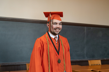 Orange Gown Graduate and triple major bound for law school