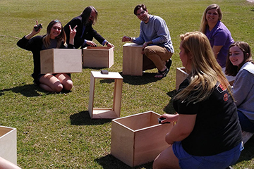 Music industry students to present hand-made cajón drums to Stillwater elementary schools