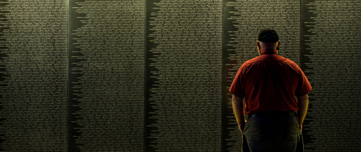 Veterans pay respect to fallen comrades by visiting the Vietnam Memorial wall