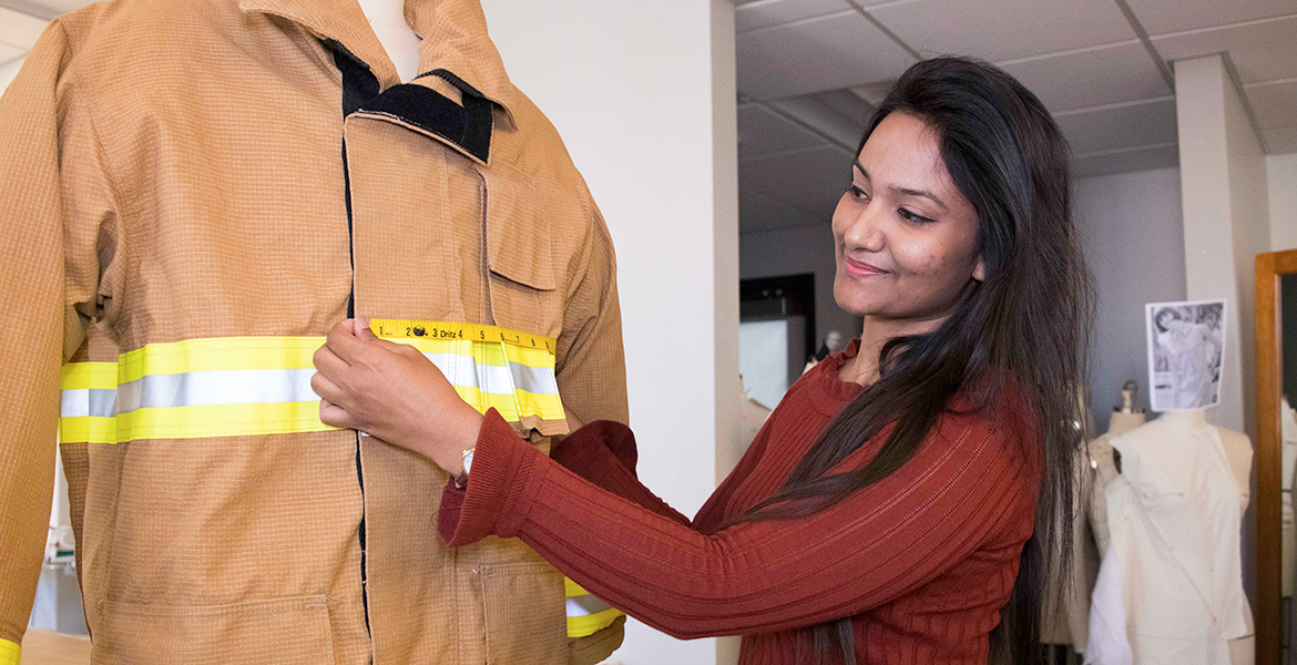 researcher measures fire jacket