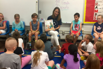Sarah Kirk reading to a class