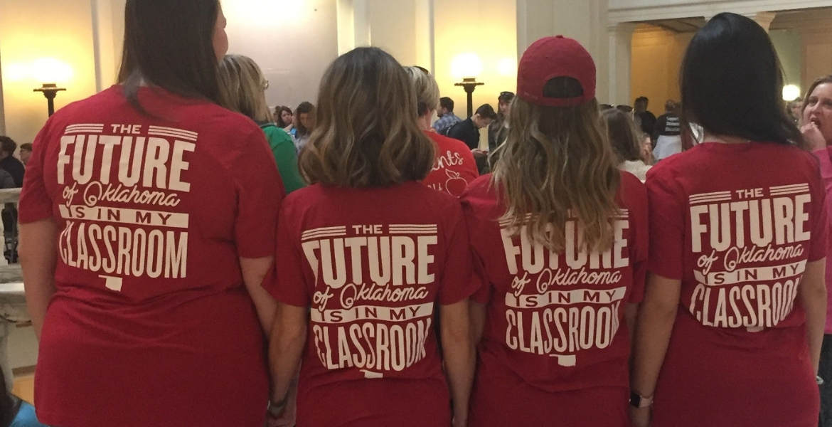 Group of teachers with tshirts at the state capital