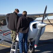 Aviation student working with a boy scout