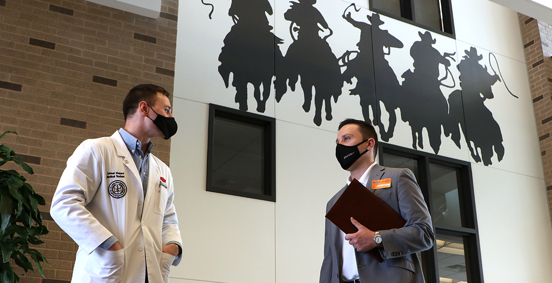 OSU medical student, and former FFA member, Samuel Shepard gives Oklahoma FFA Executive Secretary Trevor Lucas a tour of the OSU-CHS campus in November.