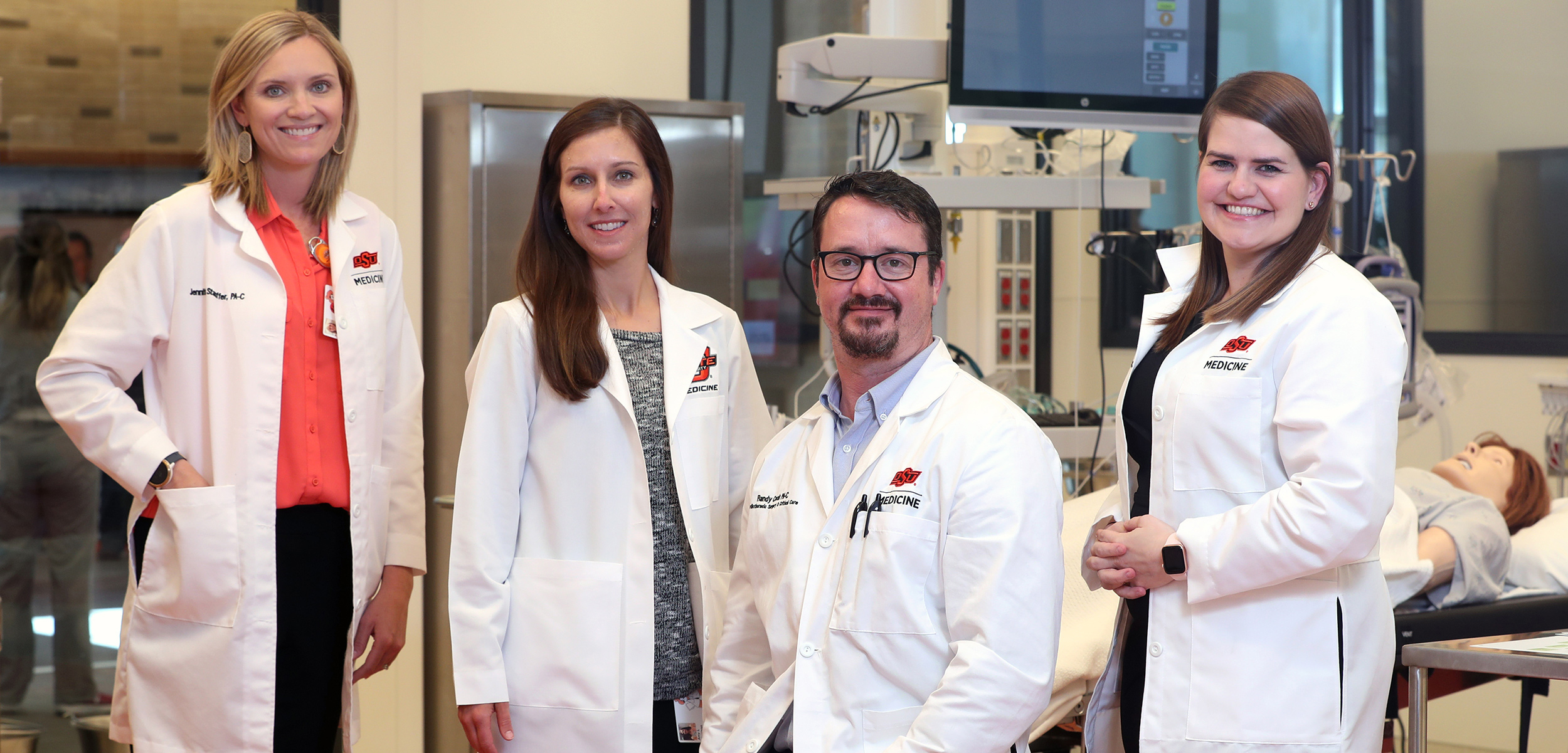 Faculty from the Physicians Assistant Program, including Jennifer Stauffer (left), Amy Harrison, Randy Cook and Rebecca Stephen (right), at OSU for Health Sciences.
