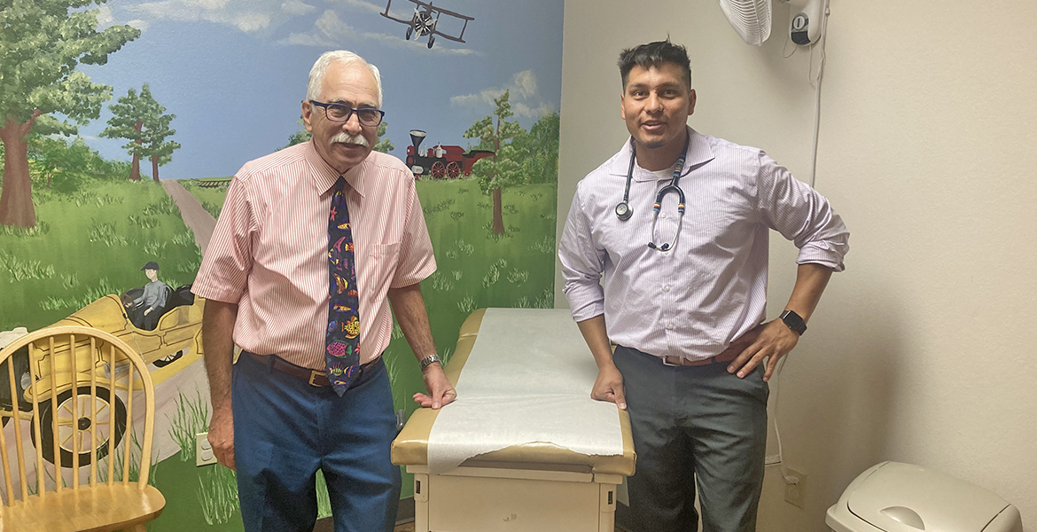OSU-COM medical student Brandon Postoak, right, with Dr. Charles Mettry, a pediatrician in Ada, Okla.