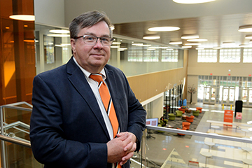 OSU instructor Steven West conquers cancer and helps the government evaluate medical research