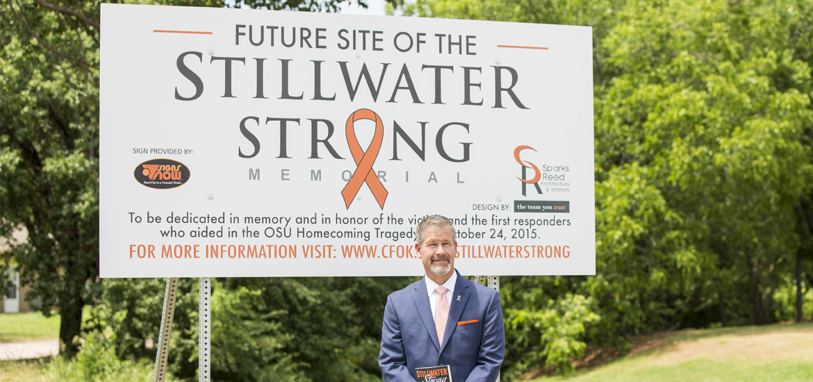 Scott Petty standing in front of the future Stillwater Strong Memorial.