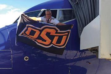 Flying Aggies join longtime pal for memorable last flight