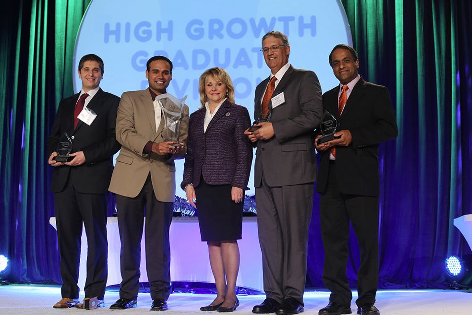 Oklahoma Gov. Mary Fallin (center) recognizes the R2R Technologies team members, from left, Aravind Seshadri, Pedro Velasco, Carlo Branca and Prabhakar Pagilla, professor of engineering, at the 2013 Oklahoma Governor's Cup.