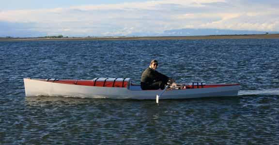 Price practices rowing in local lakes as well as larger bodies of water, such as the Pacific Ocean. Here he is pictured off the coast of Vancouver Island, British Colombia, in his specially designed long-distance boat, which includes a sleeping berth.